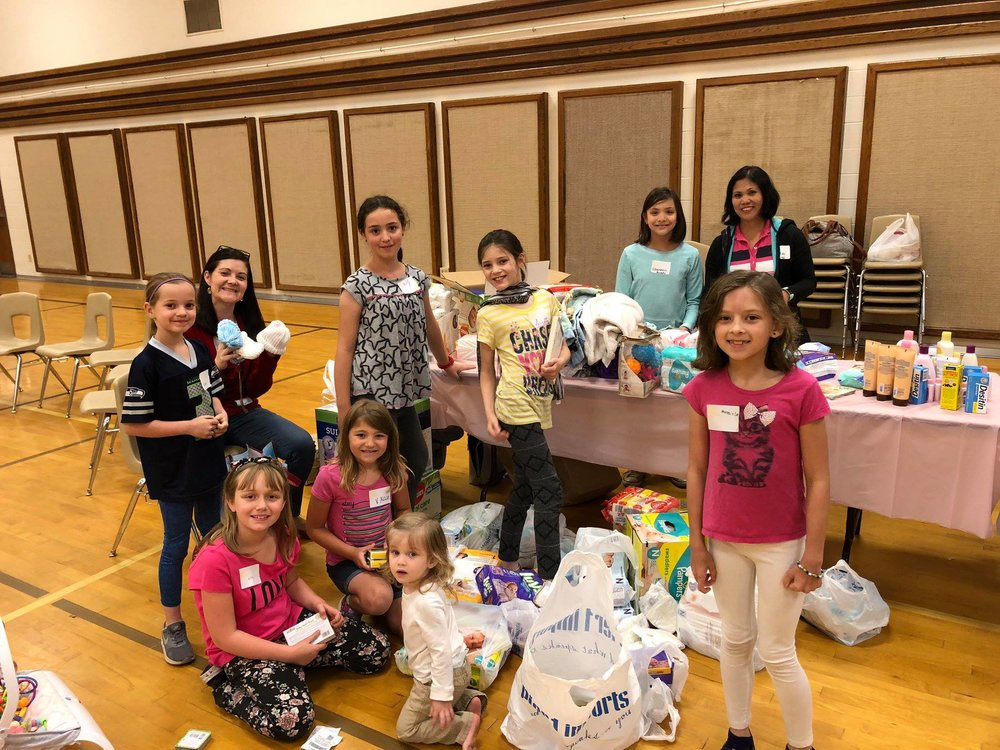 July - LDS SOUTH HILL STAKEAn energetic group of girls from the LDS South Hill Stake community spent a day collecting donations and tying diapers for our Step By Step babies. They delivered 1,500 Newborn diapers (which are always our biggest need!) along with 40 pacifiers, 850 size 1-2 diapers, baby wipes, toys, books, hygiene items, a car seat, and 86 cute baby outfits.We are so thankful for these young ladies and their families, who gave so generously. Thank you for sharing the love!