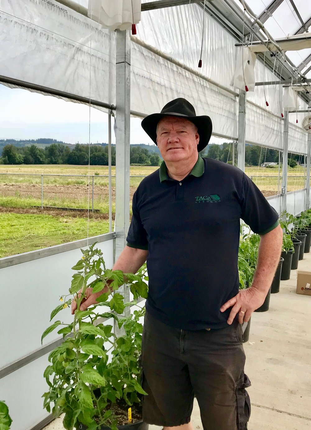 """June - DAVE HANSONDave Hanson joined our volunteer family, the day after he retired from Boeing. He has been a volunteer leader on many projects in our greenhouse. From planting tiny flowers, to lifting huge moss baskets, to experimenting with growing vegetables, Dave cheerfully does it all.Several years ago, Dave discovered Step By Step, when he helped volunteer at our annual Christmas party. He told us, """"While I was considering retiring, I knew I did not want to retire to 'nothing'. I heard Step By Step had begun the process of purchasing the former Van Lierop Bulb Farm site. I have farmed and been an avid gardener for many years. When Krista shared her vision for the property, to provide jobs and job training to help mothers, God immediately laid it on my heart that this could be a perfect fit for me. Krista loves the idea of doing some mini-farming on the property, we now have a gorgeous greenhouse, and I am all in!And, we are so happy to have you on our team, Dave! Thank you!"""
