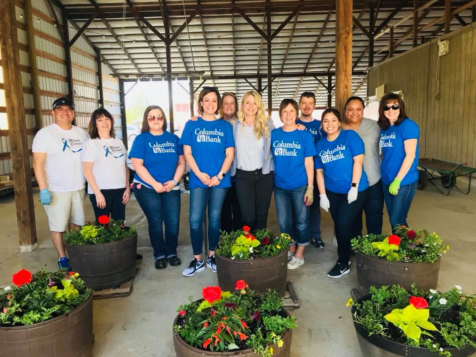 """April - COLUMBIA BANKWe were honored to have been chosen for Columbia Bank's volunteer day, as a part of a company-wide week of service, in recognition of their beloved former CEO Melanie Dressel.Melanie was a mentor to Krista Linden, our Founder and Executive Director, for two years. Krista says """"Melanie was clearly very intelligent, but she also had a unique combination of grace and strength. She was an exemplary leader, and to continue remembering her through giving back is perfect!""""Thank you, Columbia Bank employees, for planting our flower barrels, weeding and sweeping around the property, and donating diapers for our babies!"""
