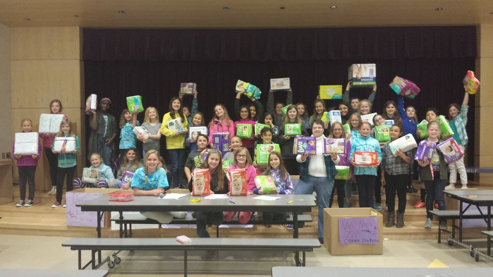 April - Maple Lawn Elementary SchoolThis Spring, an ambitious and compassionate group of 4th and 5th graders from Maple Lawn Elementary School in Sumner held a diaper drive for our Step By Step babies. Mentored by Kathy Hayden from the Sumner Rotary, through a program she developed called Early Act, and led by their teacher, Jeanne Ossman, the students created posters and managed the logistics of a school-wide drive. They brought in over 4,400 diapers to help keep our babies dry and happy!