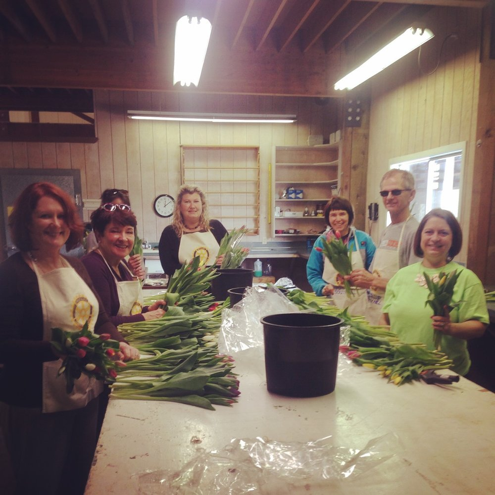 May - Puyallup South Hill RotaryWe had an abundance of tulips and other flowers that needed to be cared for and wrapped into bouquets, in preparation for our 2nd annual Mother's Day event. Thank you to Cyndi Anderson who helped organize a volunteer sign-up for the Puyallup Rotarians. We had plenty of hands on deck to help. They were even kind enough to help us out with some of the weeding around the farm, to help make the place look great for our event. Thank you so much Puyallup Rotary for coming out to the Farm and helping us get ready. We appreciate you!