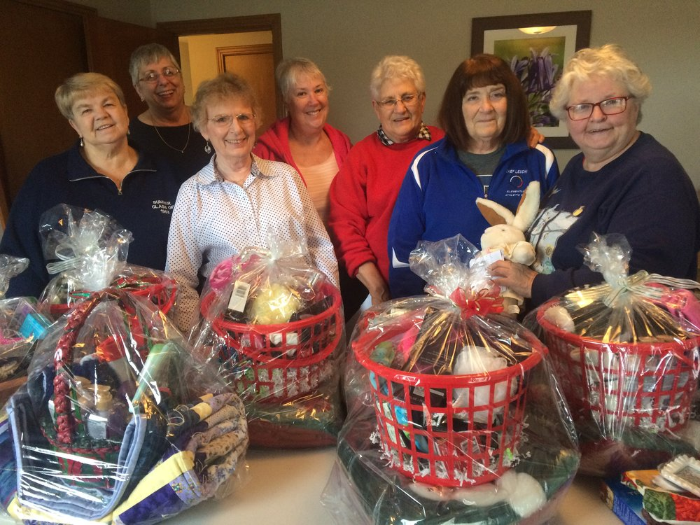 november - Nancy Sick & Beta Sigma PhiStep By Step had the pleasure of hosting a work party for the service sorority, Beta Sigma Phi, here at the farm. This delightful group of women, organized by Nancy Sick, spent the morning crafting and assembling 22 beautiful family gift baskets. The baskets were raffled off as prizes at our south end family Christmas celebration. The group generously brought a number of gifts and donations to add to the gifts. These baskets are a highlight for many of our moms and give them and their families the opportunity to spend some fun, quality time together during the holidays. Thank you, Nancy and crew!
