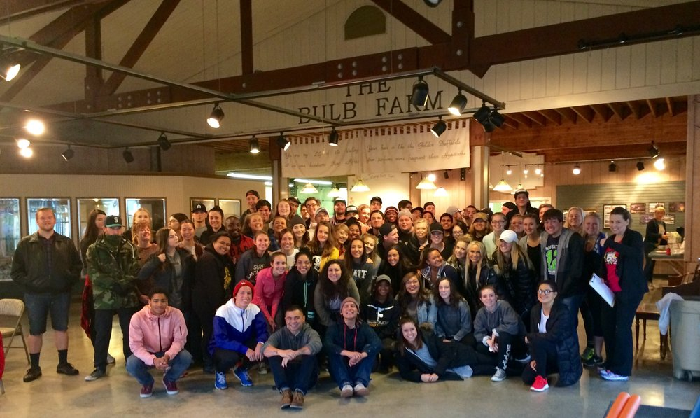 September - Ministry Institute College Interns - from Puyallup Foursquare ChurchWe hit a new record for the most volunteers at our office at one time, when the interns from Puyallup Foursquare Church arrived to help. Over 90 showed up to volunteer! They arrived with a smile on their face and willing hearts to work, and work they did! They took on all sorts of different projects, from administrative work, to helping finish off the utensil rolling for our Christmas dinners (we need 1500 sets of utensils rolled!) to helping prep for our 5K, and even some office cleaning. Whatever we needed, they did, and they even serenaded us with singing, as they worked. They are indeed a very special group of young people, and we are thankful that they decided to partner with us! We hear they may make a reappearance in the Spring, and we sure hope so! Thank you!