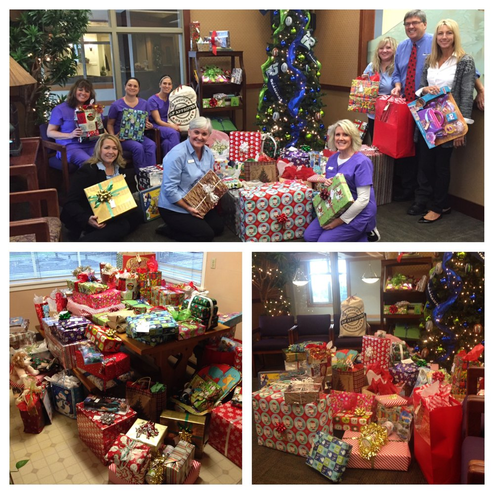 December - Dr. David Crouch's Orthodontist OfficeDr. David Crouch's office set up a Giving Tree in their office, starting in November, to bring in gifts for some of our moms and their children. They donated a sleigh-full (aka completely filled two of our staff vehicles) of beautifully wrapped presents, for over 50 of our families! When they arrived at the office, we completely filled the kitchen area with gifts. The staff couldn't stop gushing about them all day long. As we write this, all those gifts are getting loaded into different case manager's vehicles, so they can hand deliver them to their client moms. Many of our families really struggle during the holidays, and these gifts are going to bring a lot of Christmas cheer! Thank you so much for your generosity and thoughtfulness!