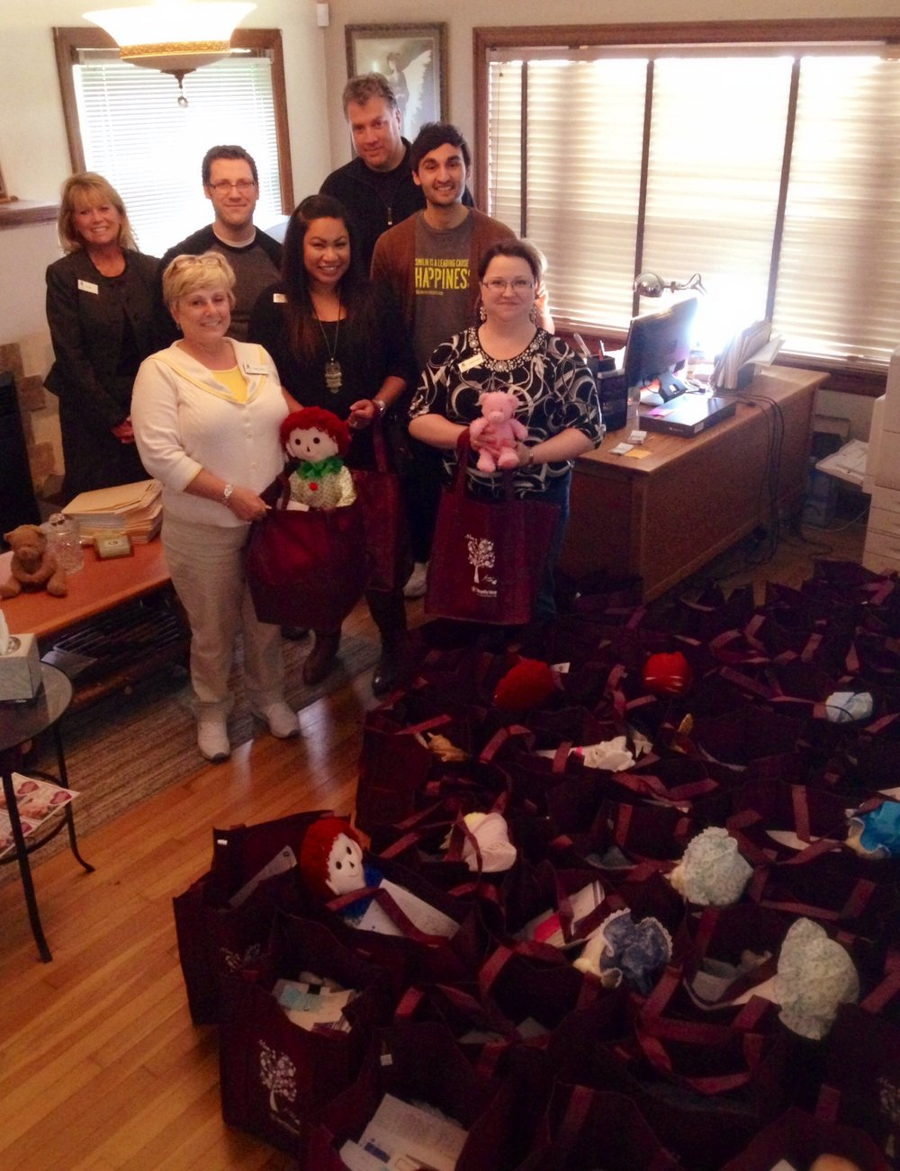 June - Umpqua Bank Volunteers & Rogers High School Key ClubUmpqua bank employees have volunteered with us a number of times over the past few years. A new group joined us a few weeks ago to help assemble charts, address envelopes, and organize items to put together gift bags for new moms. These guys are amazing workers. They always complete the tasks we give them in record time! This visit, they also put together over 60 Welcome Home bags for new moms.