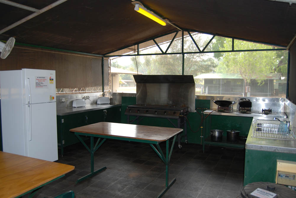 Camp Kitchen - Located in the campground is a camp kitchen for use by all guests. Cook in comfort away from the insects. The camp kitchen is fully equipped with gas cook top and BBQ, sink, table, seating, fridge, and various other kitchen equipment.