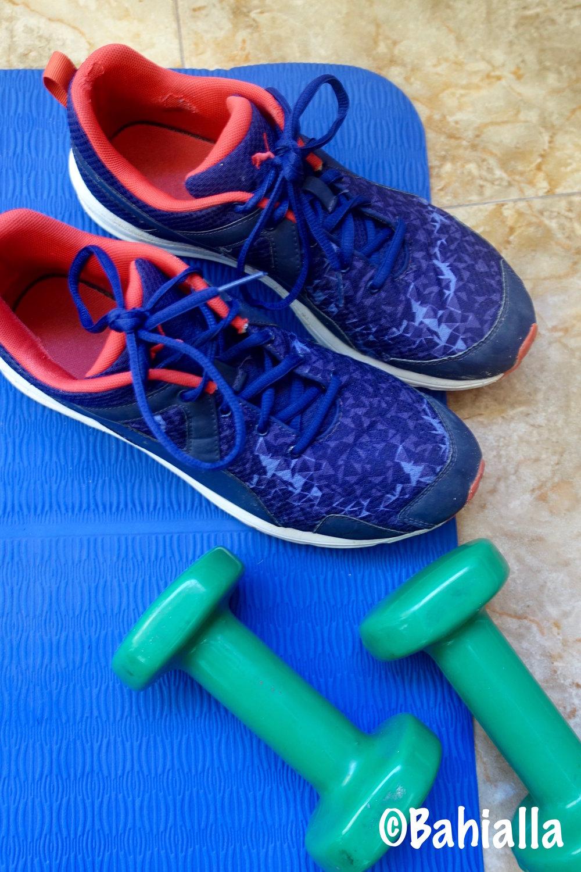 tennis shoes dumbbells