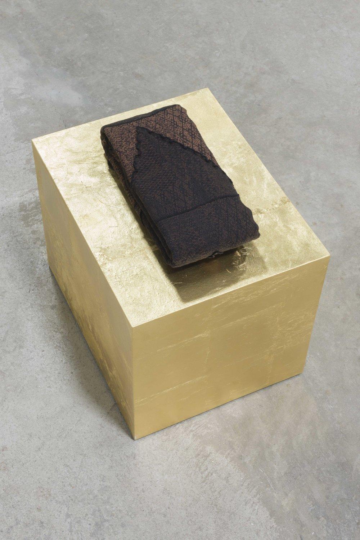 "Sacred Cloth II  (cloth folded) 12"" X 8"" (pedestal) 14"" X 18"" 14,"" 2017, cotton, gold-leaf, & wood"