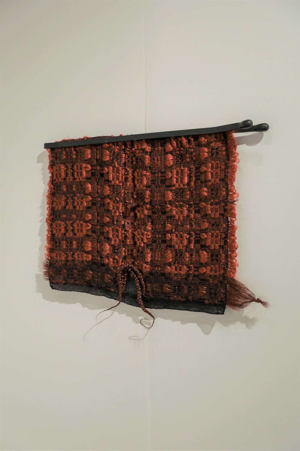 """Burnt Orange Overshot  2018, 26"""" (W) X 27"""" (L), Cotton, synthetic hair, metal, and spray paint. Photographer: Sergio Mantilla  SOLD"""