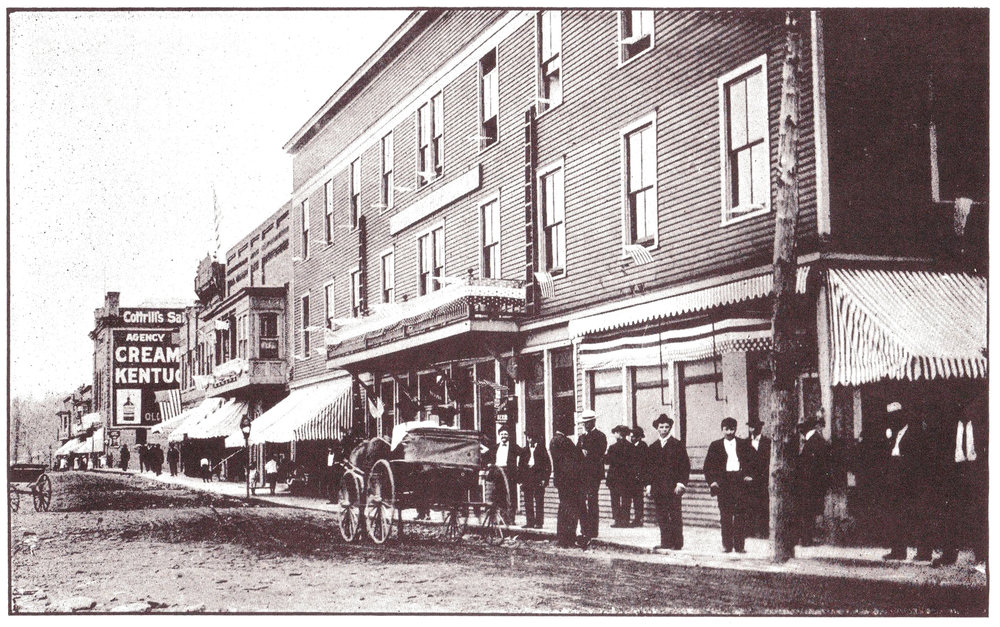 "East Avenue (Front Street) in Thomas, West Virginia, circa 1906. The Opera House is visible at the end of the street (look for the painted ""Cottrill's Saloon"" sign)."