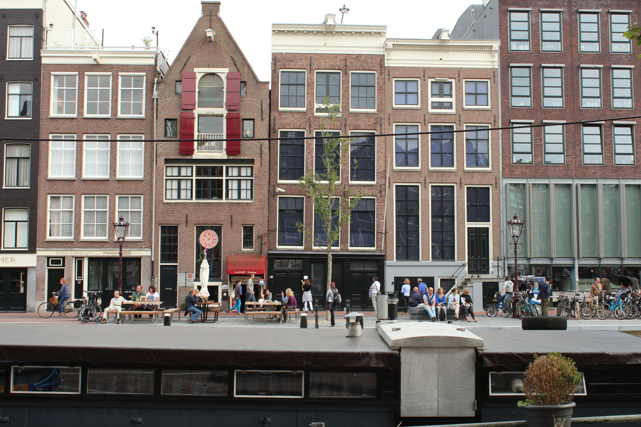 The Anne Frank house, the actual house where she and her family hid in the attic, is in the center with the tree, Prinsengracht 263. The actual house, the one to the right and the modern buildings farther right comprise the Anne Frank House (the museum).