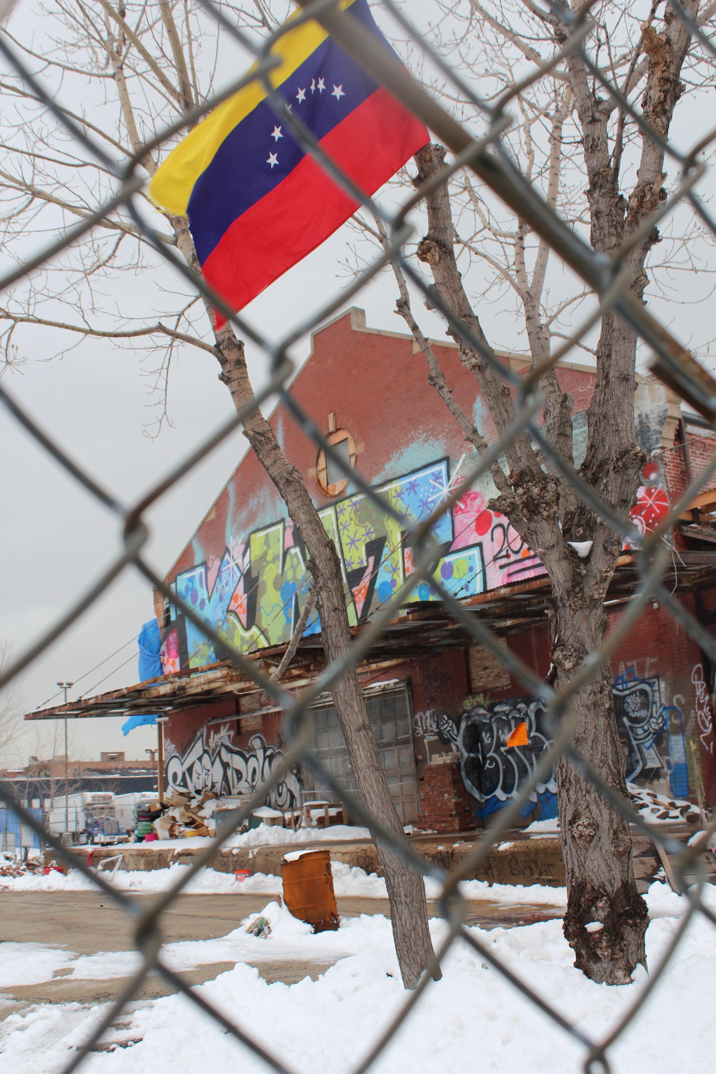 Venezuelan flag flies the day after their President, Hugo Chavez, passed. Graffiti, Chicago.