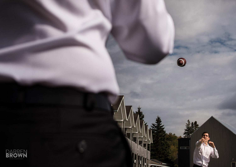 groomsmen playing football wedding photography