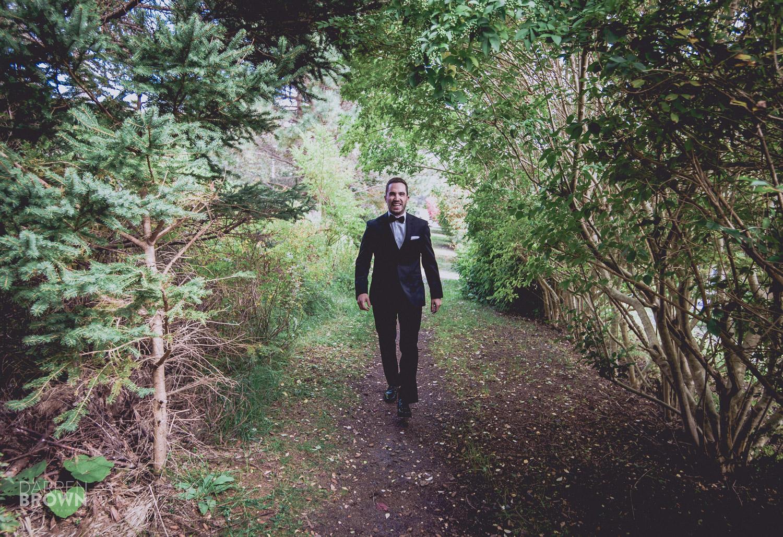 groom walking through woods
