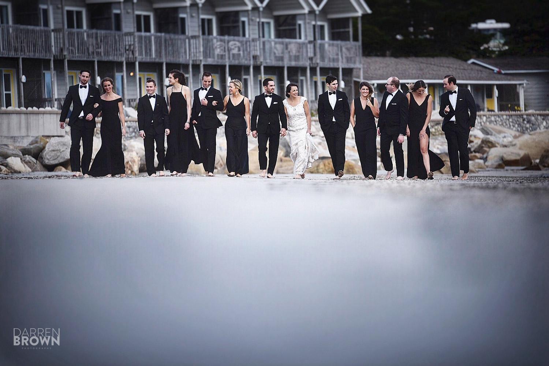 bridal party portrait by ocean