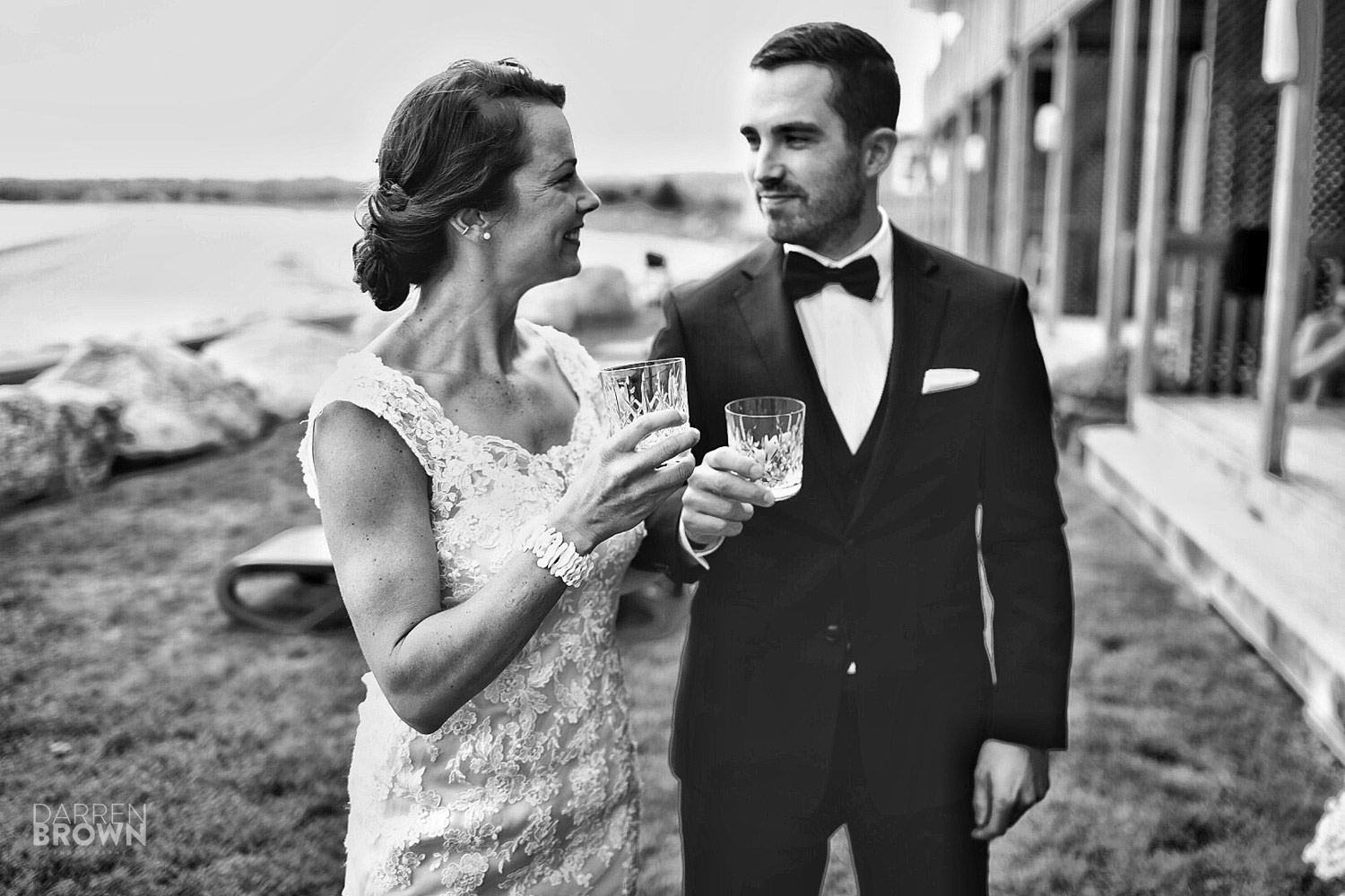 bride and groom share drink