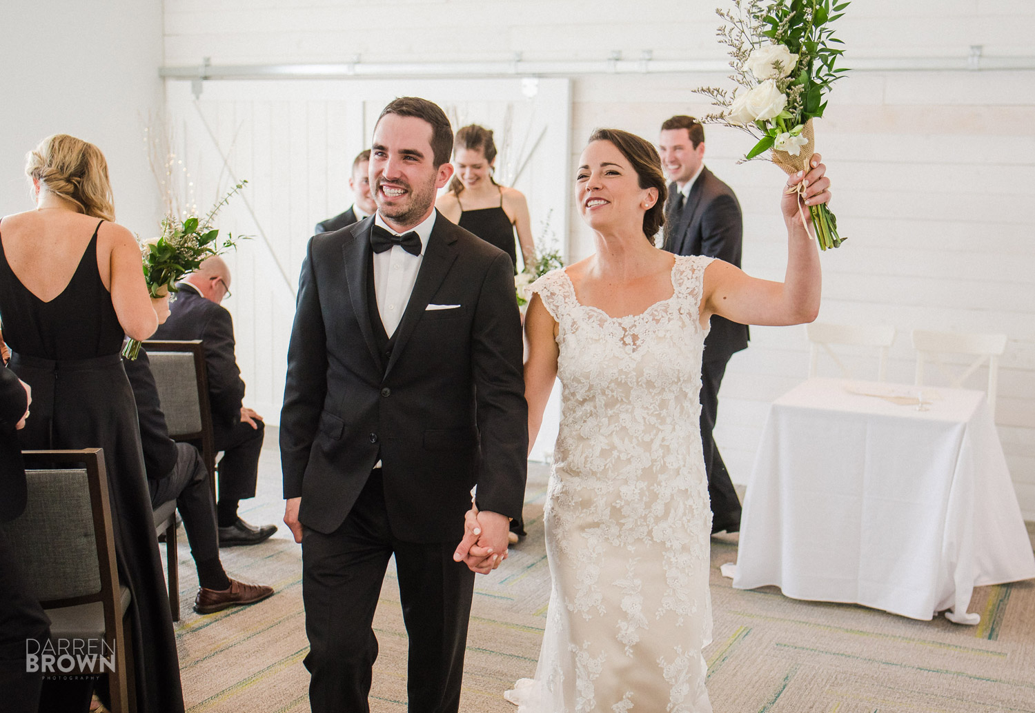 bride and groom celebrate after wedding ceremony