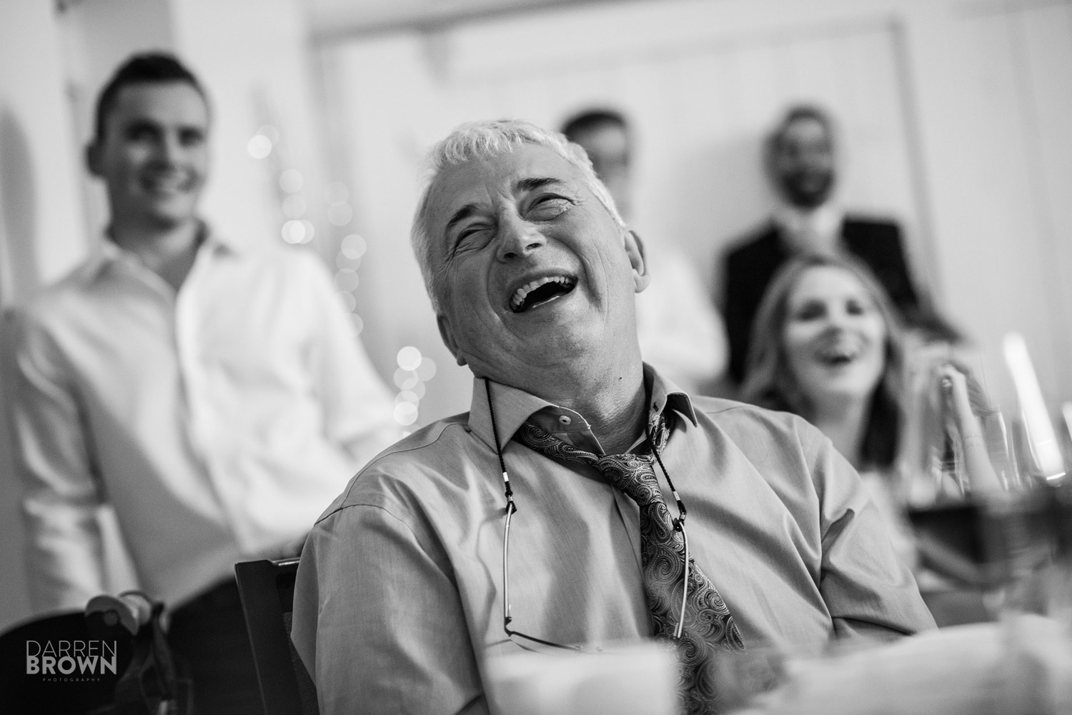 father of the bride laughs