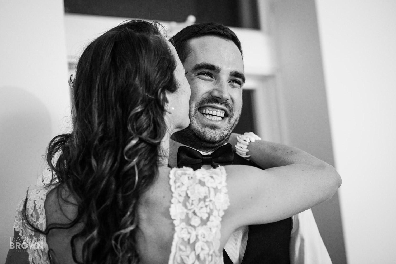 bride kisses happy groom
