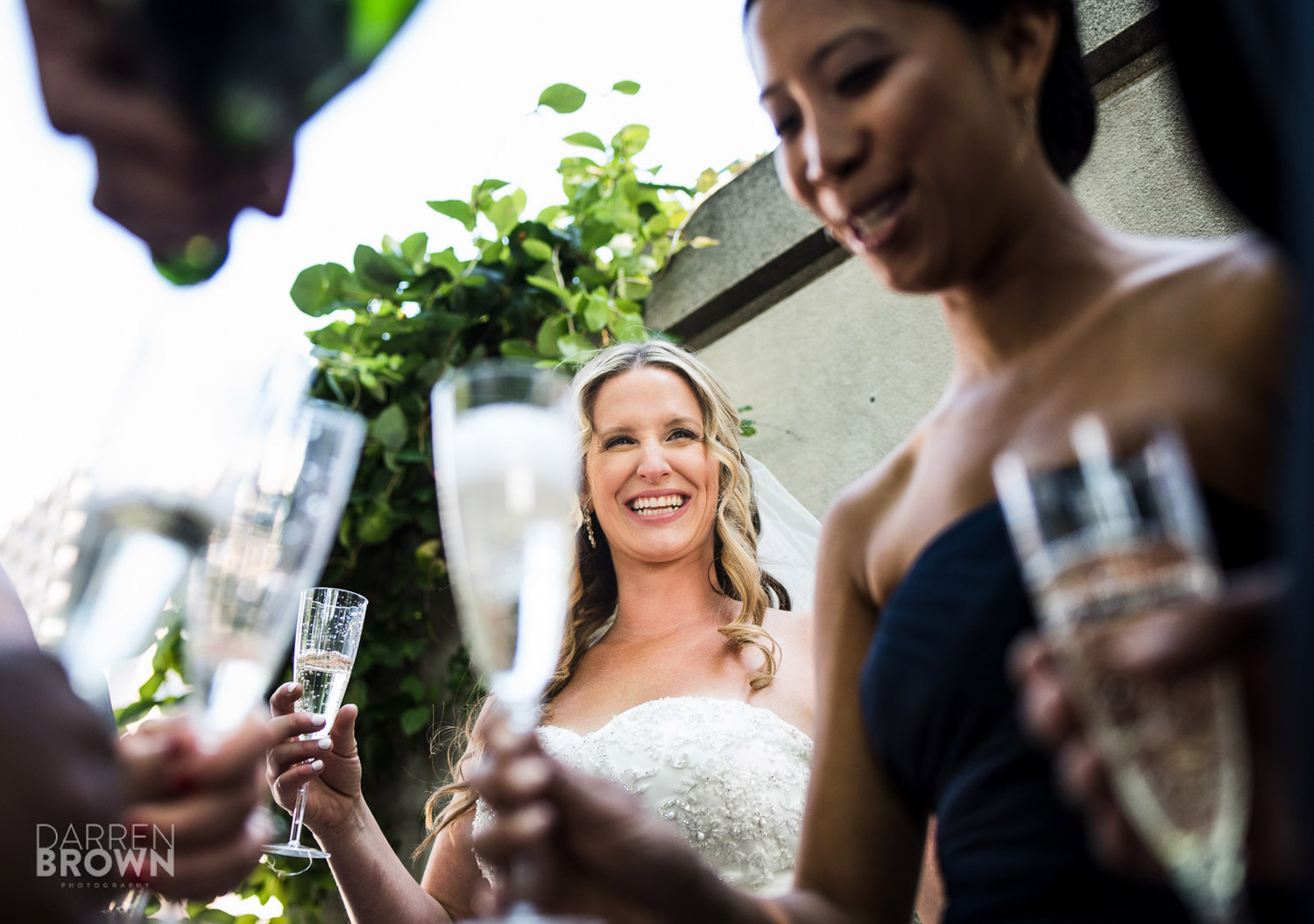 bride smiling during champagne toast
