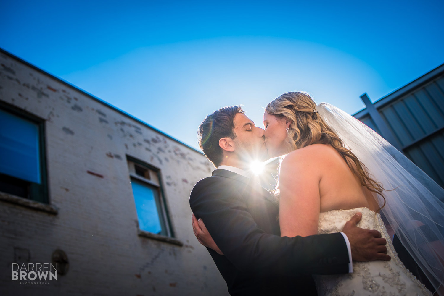 bride and groom first kiss at zibi wedding in ottawa