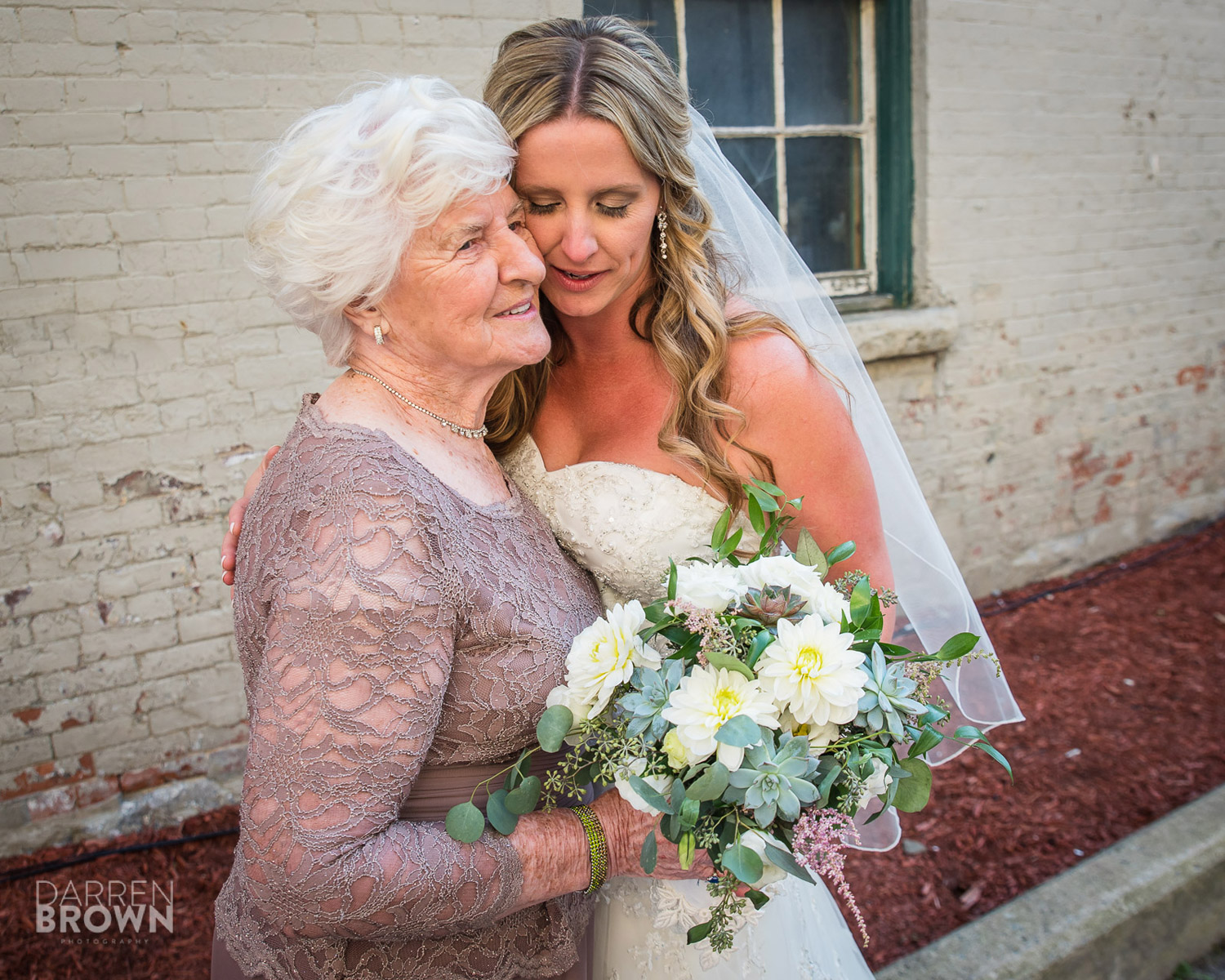 bride hugs grandmother at zibi wedding in Ottawa