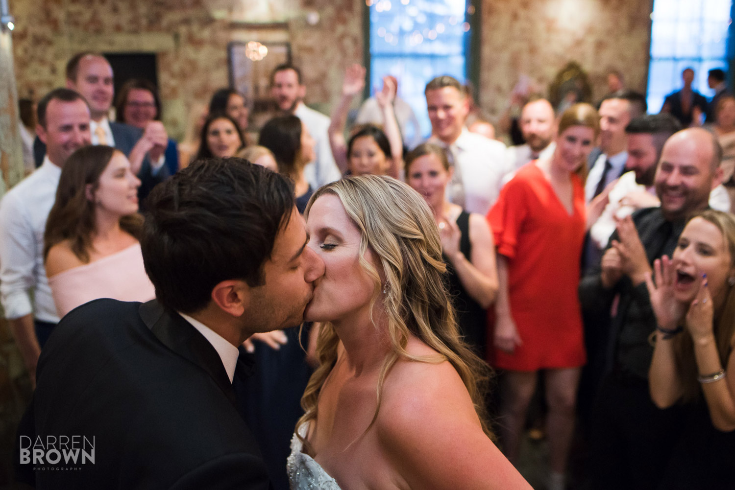 bride and groom kiss during ottawa wedding reception at zibi