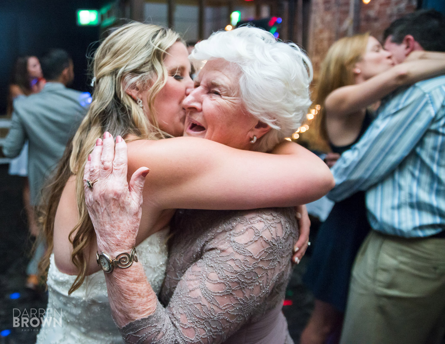 bride hugs grandmother during ottawa wedding reception at zibi