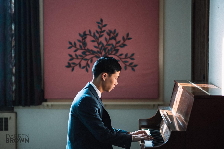 groom playing piano