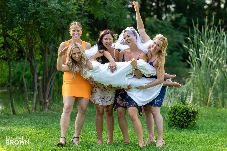 fun bride photo with bridesmaids