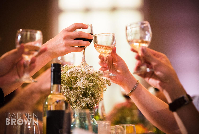 wine glasses clinking at ottawa wedding ceremony