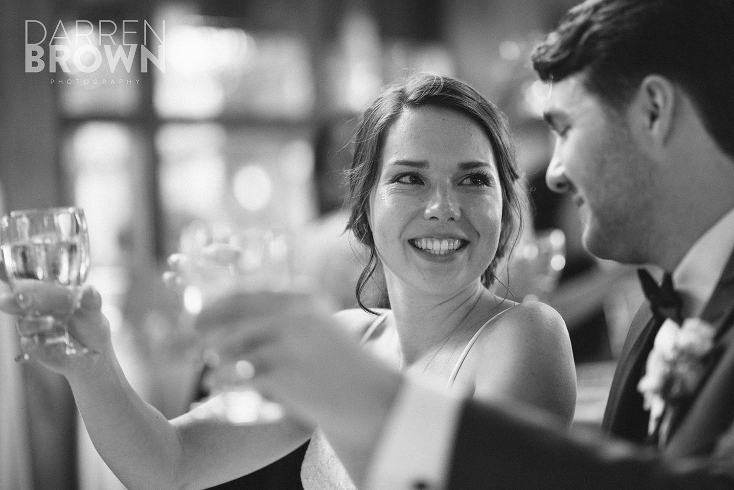 bride and groom toast during ottawa wedding reception