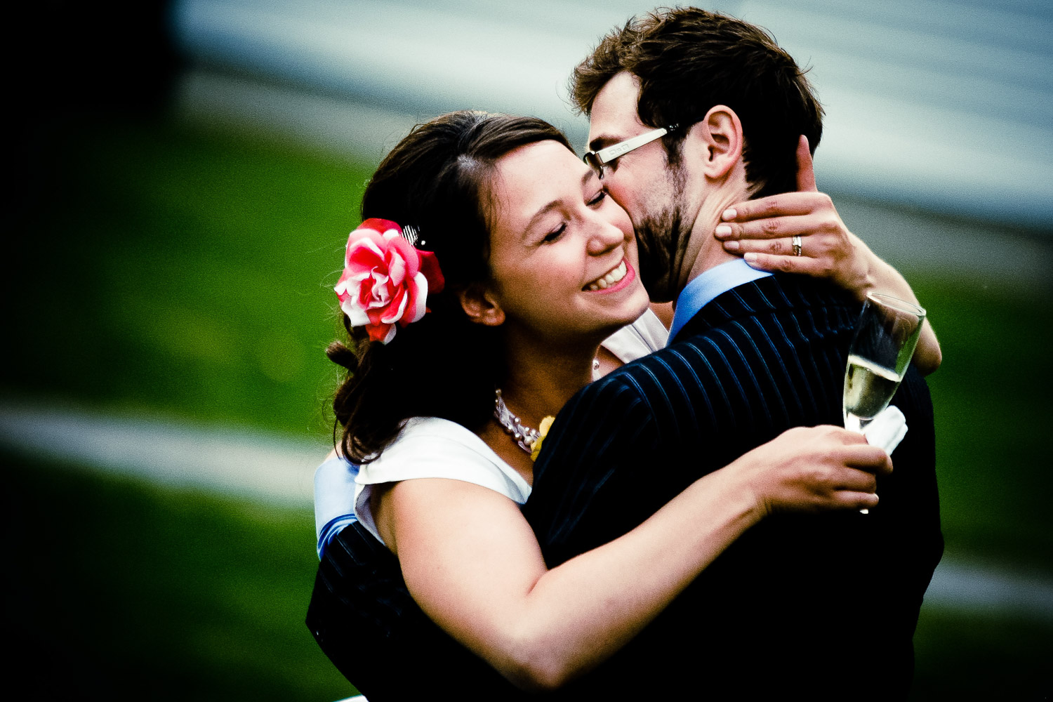 bride hugs groom during ottawa wedding at billings bridge