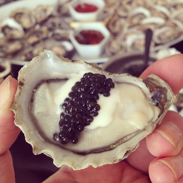 #4 Enjoying a plump Kusshi oyster with some creme fraiche and caviar at Oyster Nosh.