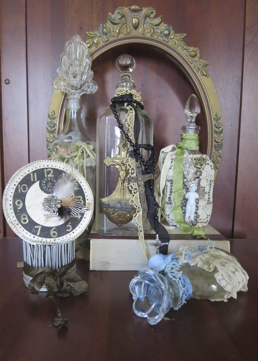 altered salvage bottles with vintage stoppers and clock face copy.jpg