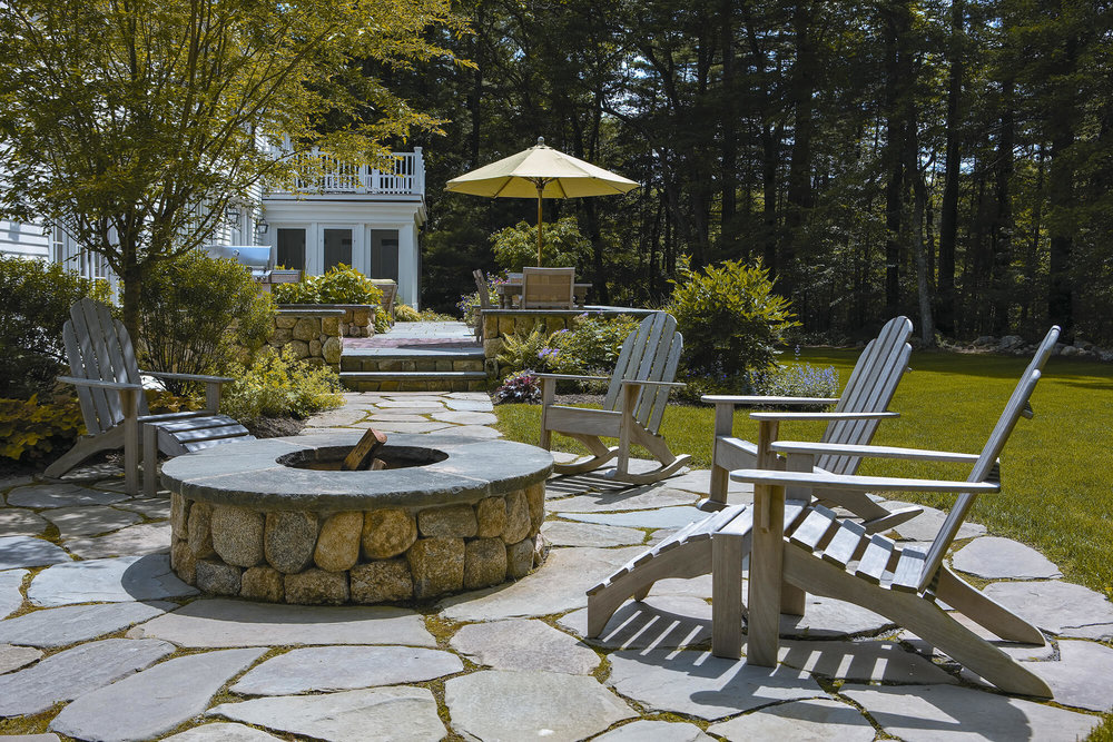 Fire Pit on Stone Patio with Seating