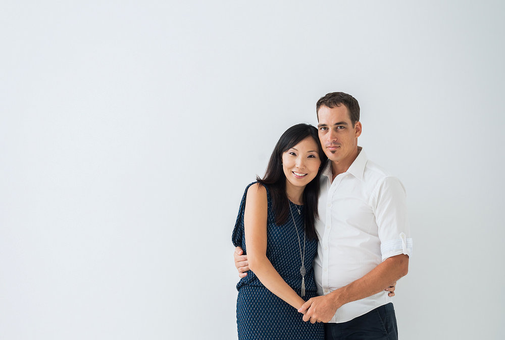 photographer-and-wife-smiling-at-camera.jpg