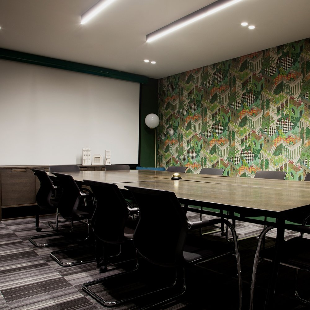 The Interchange - Set against a backdrop of theatrical wallpaper and moody, dark green walls, this versatile space features a private entrance, modern seating and a generous, contemporary conference table that is perfectly suited for boardroom deliberations, executive retreats or private dining experiences.