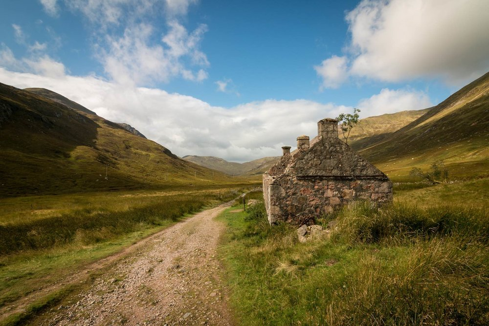 Scotland rural road and old house