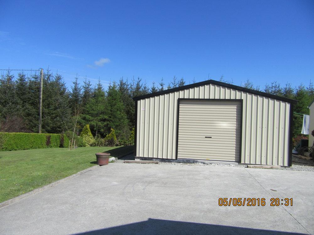 A1-Sheds-Cork-Steel-Shed-Garages-Roller-Doors-Cladding.JPG