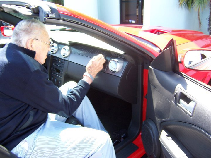 Carroll Shelby autographing the dash of the prototype Retrobuilt Shelby GT500-CS Convertible.