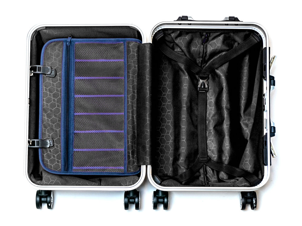 Organization on the go - The compression flap is perfect to place your included packing cubes while the strap compression is perfect for large items.