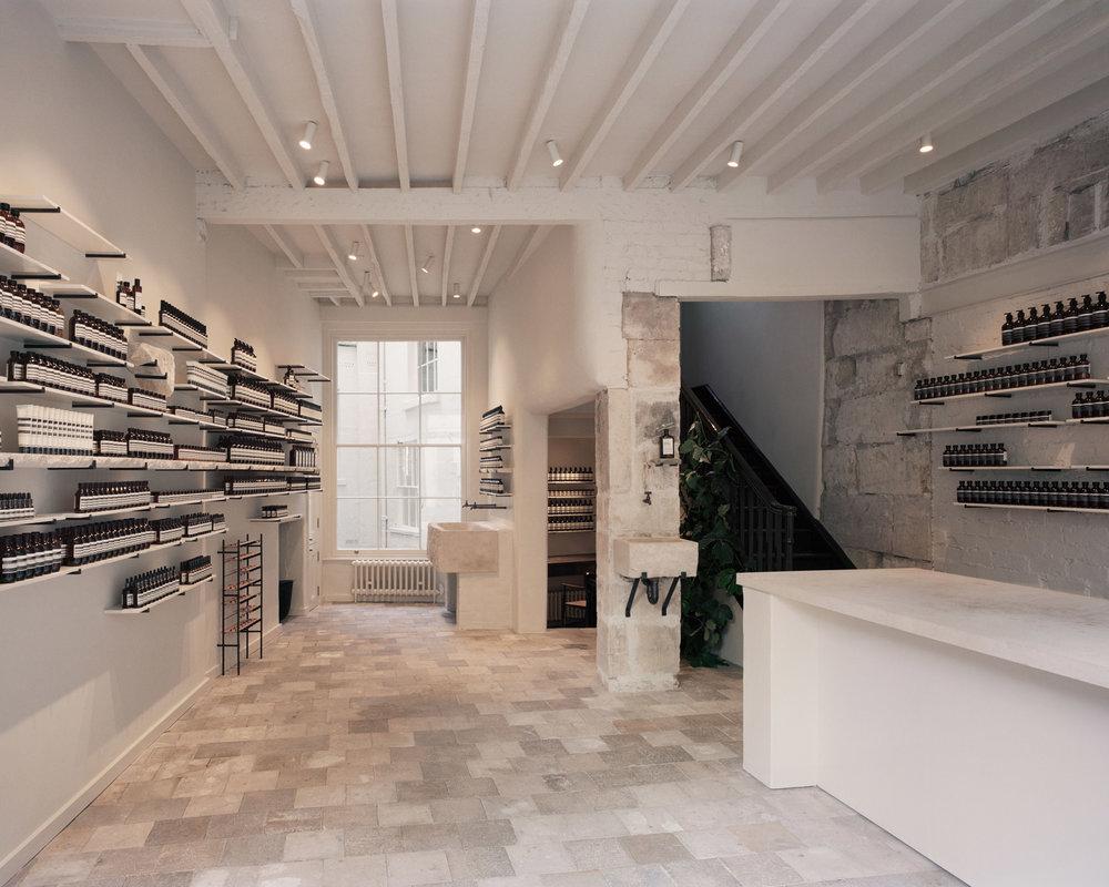 Reclaimed floor tiles in Aesop Bath designed by James Plumb