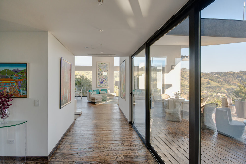 Hallway with large sliding doors onto deck.