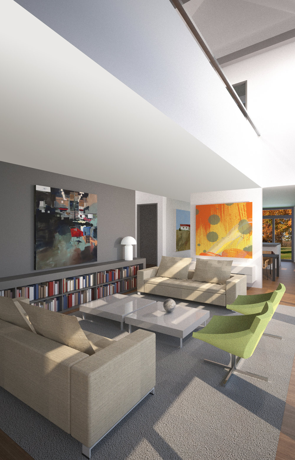 Large living room with colorful art and low bookshelves.