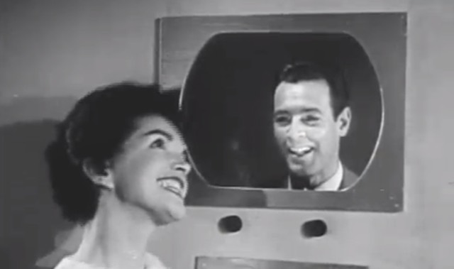 Woman talking on a videophone in the 1955 short film The Future is Now