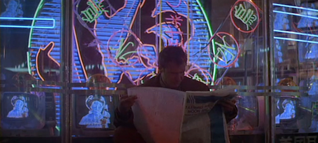 Rick Deckard reads a newspaper in the year 2019 in Blade Runner (1982)