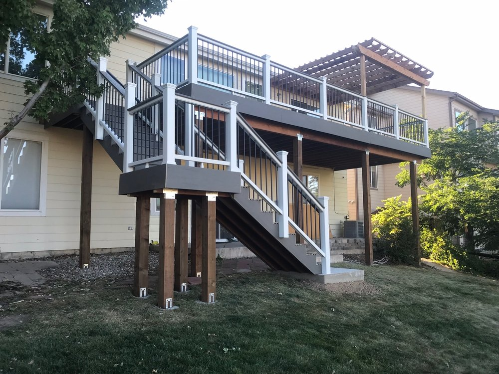 deck stairs with white railing - denver deck builders.jpeg