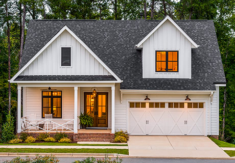 COACHMAN® COLLECTION - The perfect blend of beauty and practicality, these carriage house doors look like wood, but they are actually crafted of multiple layers of durable, low-maintenance steel and insulation topped with a wood-grain textured composite overlay.