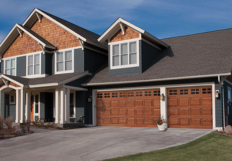 CLASSIC™ WOOD COLLECTION - Unlock the beauty of natural wood with a handcrafted hemlock, redwood or cedar garage door from Clopay®. These handcrafted wood garage doors feature traditional raised, recessed and flush panels that allow you to choose the best look for your home and its architecture. The addition of a wood garage door from Clopay® can transform the appearance of your home's exterior and greatly enhance its curb appeal.